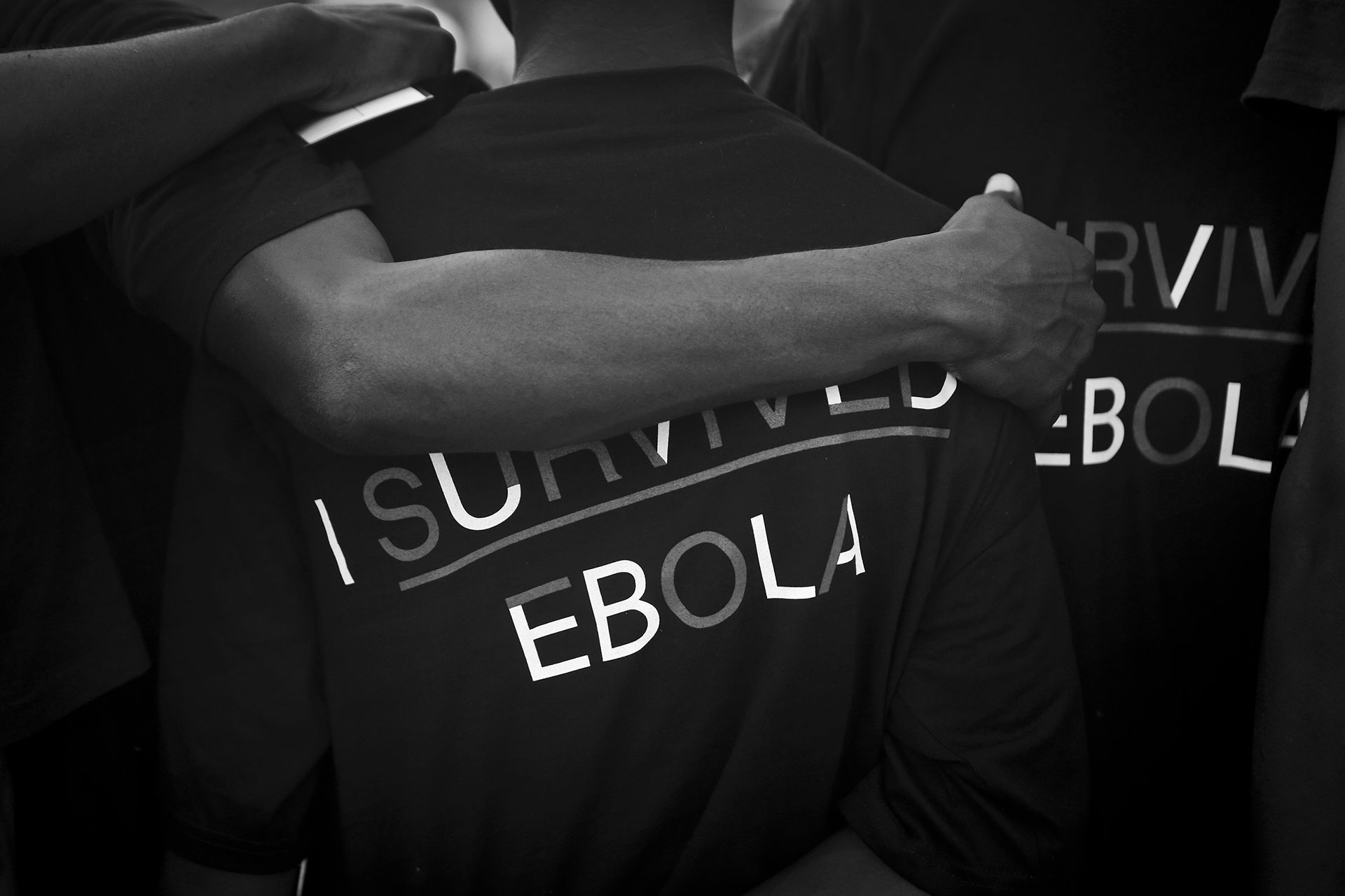 Men who are part of the Ebola Survivor's Soccer Club wear t-shirts at a soccer practice in the city of Kenema, 190 miles east of the capital Freetown, Sierra Leone, Tuesday, April 21, 2015. In 2014, 38 members of Erison Turay's family died from the deadly Ebola virus, which has killed over 11,000 across West Africa. Erison founded the Ebola Survivor's Soccer Club as a support network for survivors and a means to battle negative stigmas in the community.