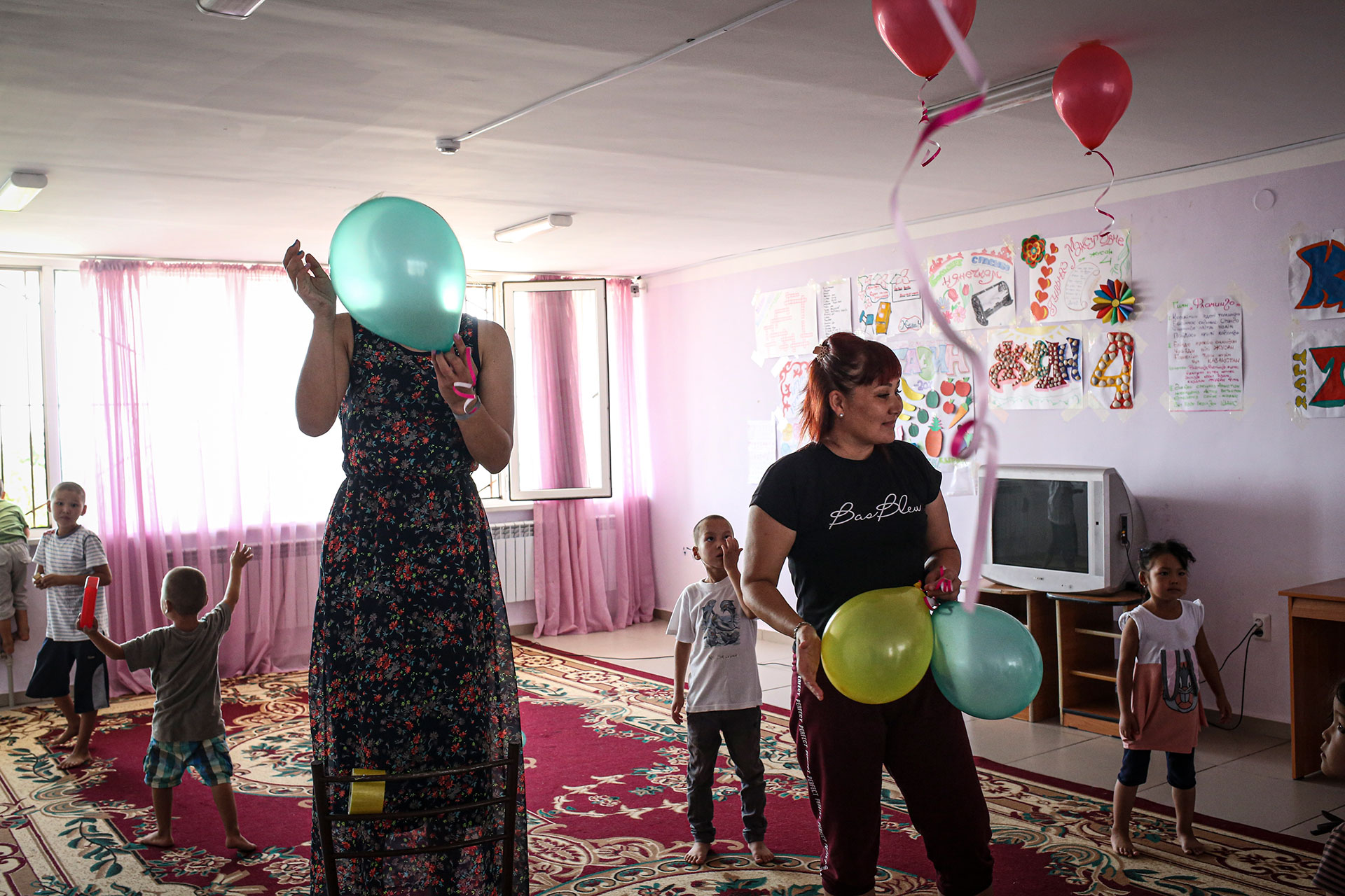 "Teachers and helpers set up for a child's quiz in the playroom of a rehabilitation center for former ISIS wives, in Aktau, Kazakstan, Monday July 22, 2019. The Kazakh government converted an old day camp into a ""rehabilitation center"". There, the women, who usually come with their children, get treatment from psychologists and moderate Muslim imams intended to cure their radicalism and re-integrate them into society."