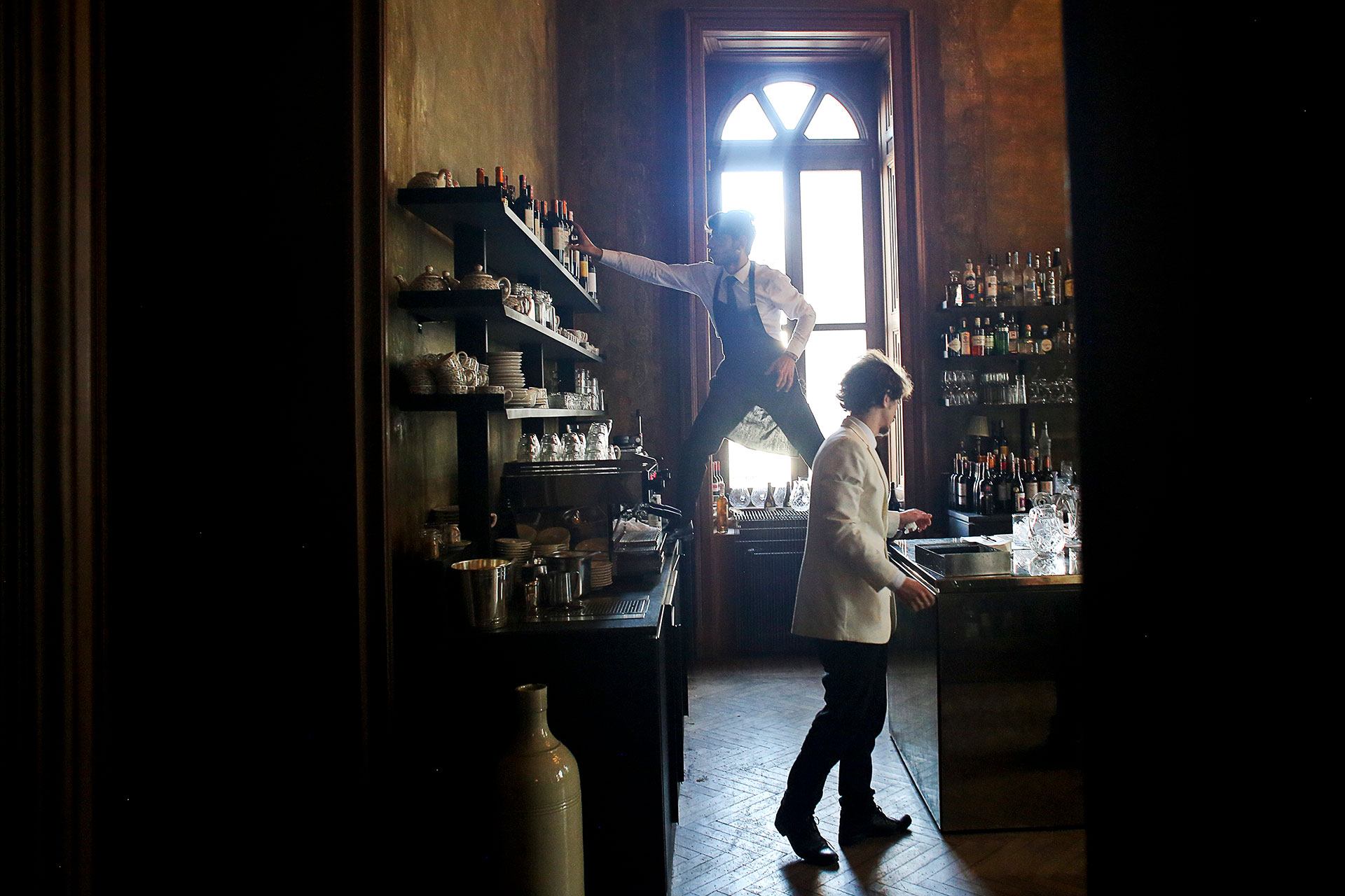 Waiters work in the kitchen of Soho House, Istanbul.